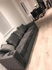 Grey 4 seater studded sofa