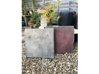 10 Used Concrete paving slabs Grey, one with a broken corner.