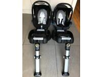 Two maxi cosi car seats and isofix bases