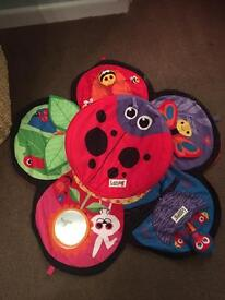 Lamaze tummy time spin and explore garden play