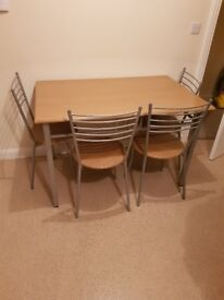Kitchen table and 4 chairs. 2 chairs need recovering. Collection only