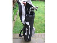 New golf bag and assortment of clubs