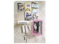 Wii console 2 remotes 1 nunchuck 5 games