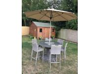 Garden bar table with six chairs and parasol
