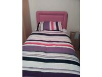 Single deep base divan bed with storage draws