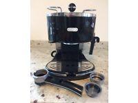 DeLonghi espresso coffee machine in black and chrome.