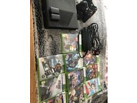 Xbox 360 with hard drive, games, wireless controllers and dock