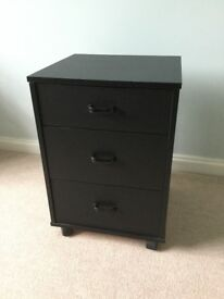 IKEA black 3 drawer cabinet with castors.