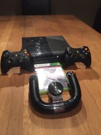 Xbox 360 E With two controllers and one steering wheel controller. (Good Condition)