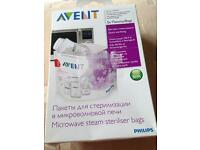 Avent microwave Steam Steriliser bags and 2 bottles