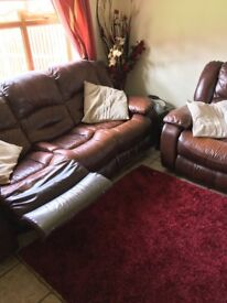 Brown leather reclining 3 piece. (3 2 and 1)