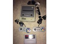 Super Nintendo snes console and mario kart