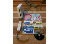 Nintendo Wii console with one controller & games inc wii sports and wii sports resort