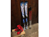 KIDS SKIS BOOTS AND POLES ONLY USED FOR ONE SEASON