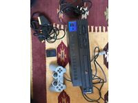 PlayStation 2 Console With 2 Games