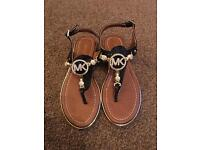 Pair of brand new Michael Kors black / tan / gold sandals with diamonds
