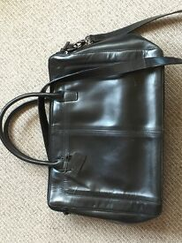 Woman's black leather briefcase
