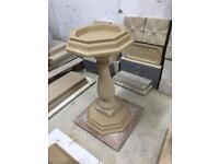 Cast stone bird bath