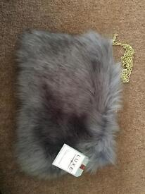 In the style grey Faux fur bag
