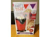 As new Party Time red popcorn maker