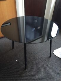Black round glass table with metal legs. Great condition £25