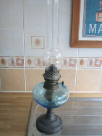 Antique oil lamp with glass