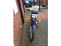 honda 125 motor cycle good condition for the yearvery economical full mot