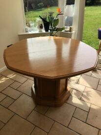Solid oak extending dining table with six chairs