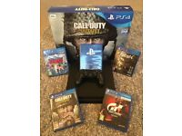 PS4 Slim 500GB with controller, original box + 4 games inc. Call of Duty WW2. Only used a few times!