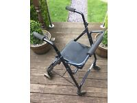 walikng aid with seat and breaks good condition
