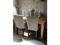 Beautiful solid oak dining room table with four chairs in immaculate condition