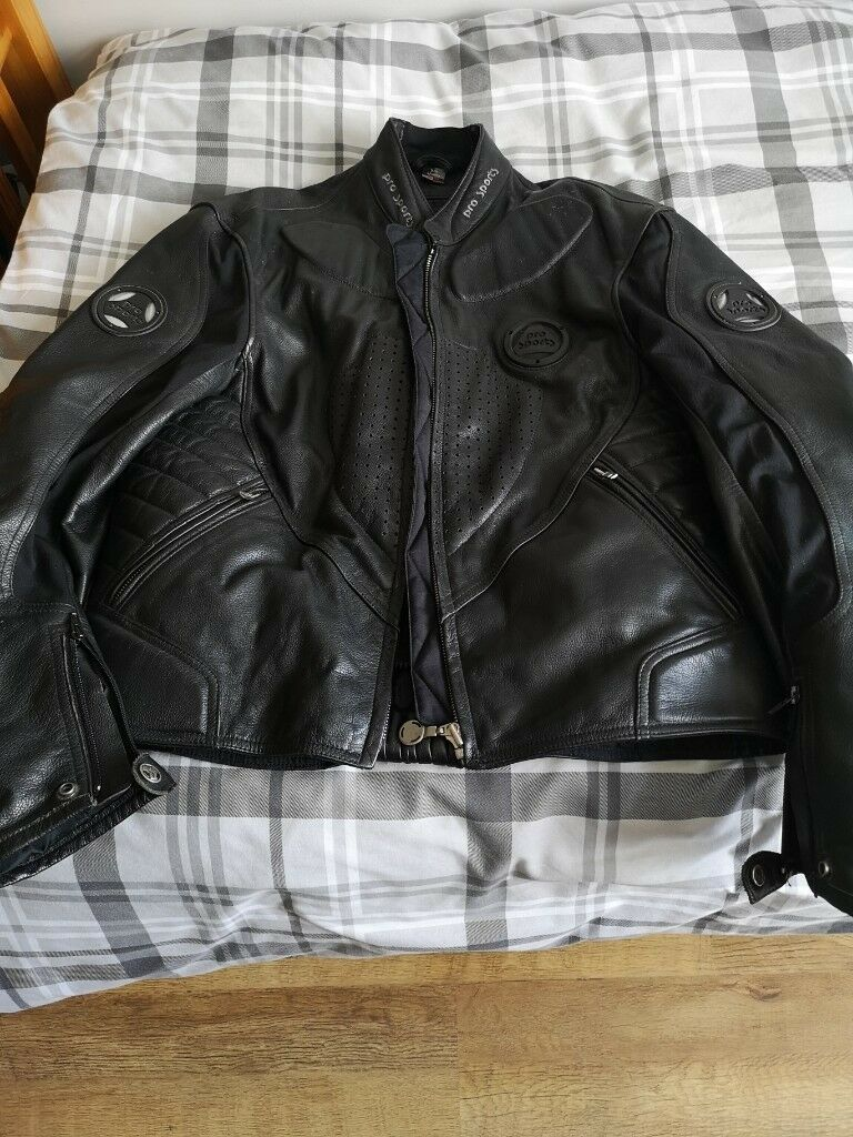 Swap Leather motorcycle jacket and trousers, size M - L, 2 pairs of gloves and helmet for sale.