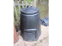 Two black composter bins