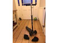 Black Maxi Micro Scooter plus poggies.... Good condition