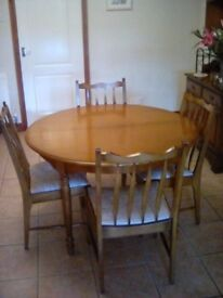 Stag light oak extending dining table plus eight chairs