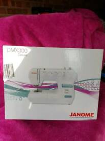 New & Boxed Janome DMX300 Deluxe Sewing Machine Singer