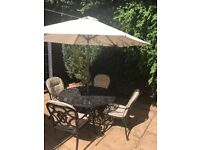 black aluminium table with 4 chairs very good condition height 73cm width 123cm