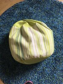 Green small round foot rest beanbag