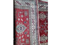 Handmade 100% wool Asian rug, mainly red in colour