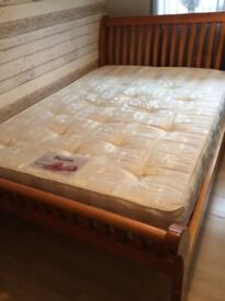 Large solid wood double bed