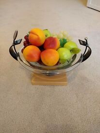 Glass fruit bowl with fake plastic fruit