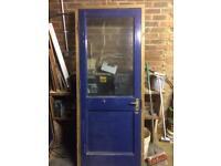 Security glazed garage door and frame