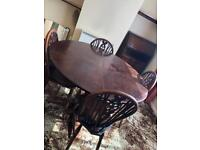 Dark wood table and 4 chairs for sale