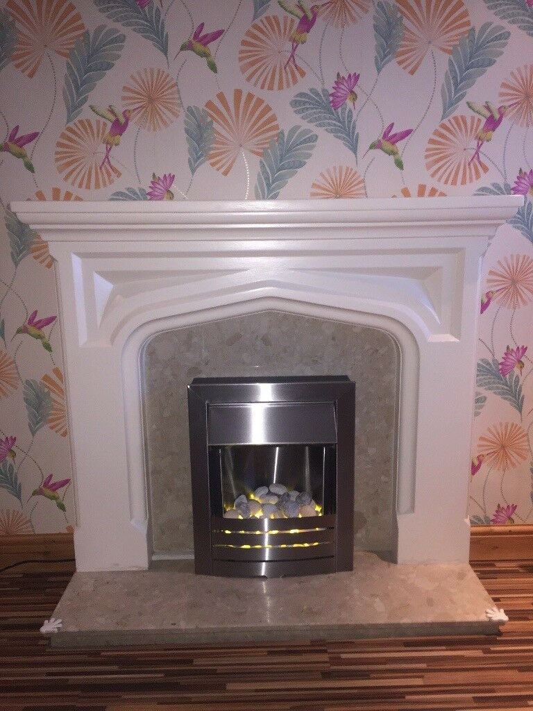 Plaster fireplace, marble surround and hearth and 2kw electric fire all in good condition
