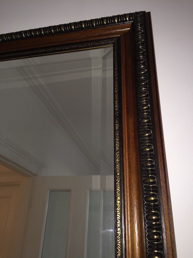 Large immaculate mahogany and brass mirror with bevelled glass.