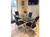 Glass table (extending) and 4 chairs