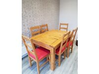 Solid pine extendable table seats 6-8 including 6 chairs. Very good condition.