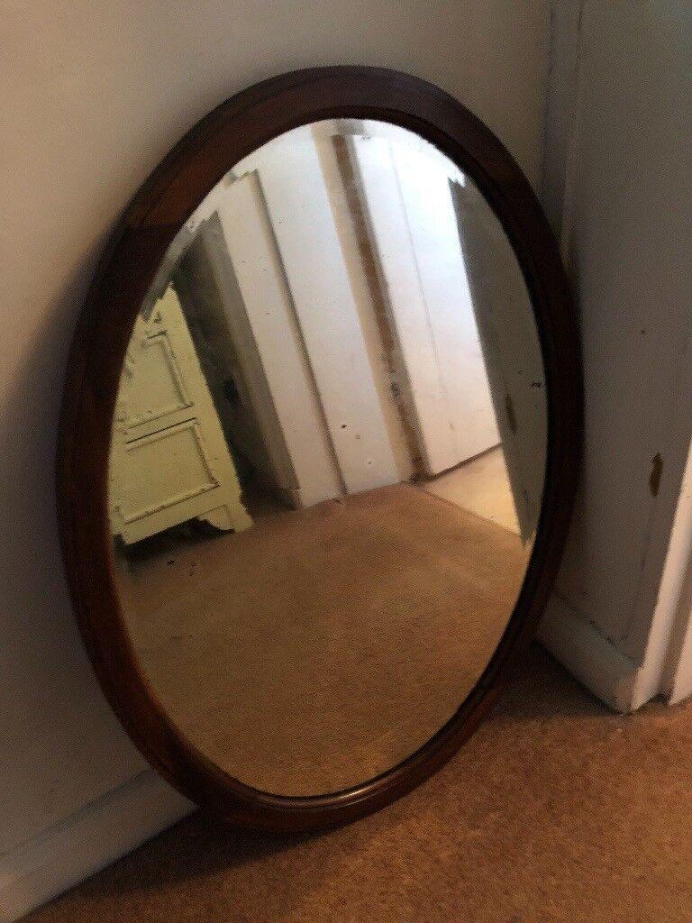 Oval wooden framed vintage bevelled edge mirror