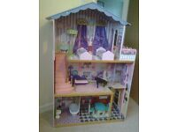 Large dolls house with wooden furniture