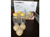 Medela Swing electric breast pump. Includes 3 8oz bottles and calma teats.